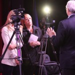 News teams from WPTZ and Fox 44 interview VT Attorney General William Sorrell.